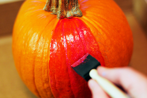 painting rainbow glitter pumpkin